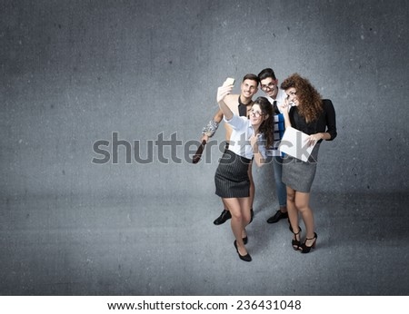 business team made selfie with phone - stock photo