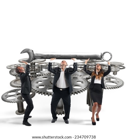 Business team makes maintenance of a system of gears - stock photo