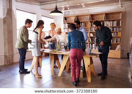 Business Team Meeting Around Table For Brainstorming Session - stock photo