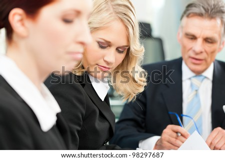 business team meeting in an office the boss with his employees business nap office relieve