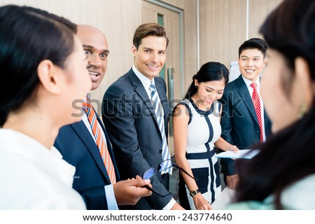 Business team meeting of Asian and Caucasian executives, Indian CEO explaining the strategy   - stock photo