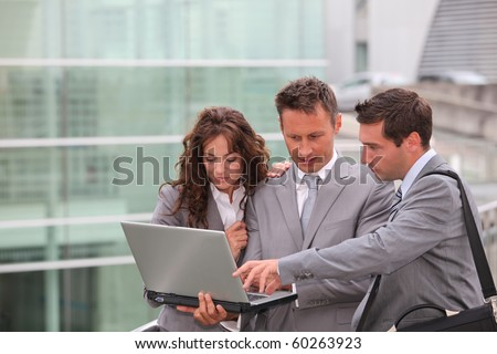 Business team meeting outside the office - stock photo