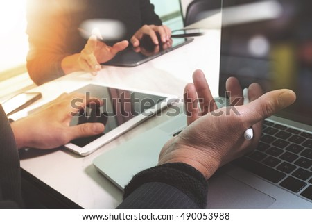 Business team meeting present. Photo professional investor working with new start up project. Finance managers task.Digital tablet laptop computer design smart phone using, Sun flare effect
