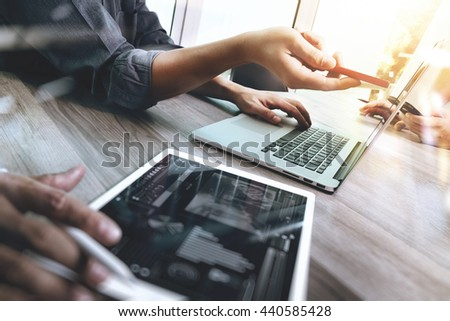 Business team meeting present. Photo professional investor working with new startup project. Finance managers task.Digital tablet laptop computer design smart phone using, Sun flare effect - stock photo