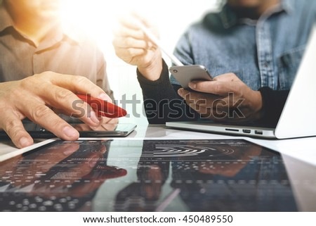 Business team meeting present. Photo professional investor working with new startup project. Finance managers meeting.Digital tablet laptop computer design smart phone using. Sun flare effect  - stock photo