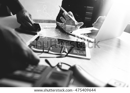 Business team meeting present. Photo professional investor working with new startup project. black and white.Digital tablet laptop computer design smart phone using.Sun flare effect, black white