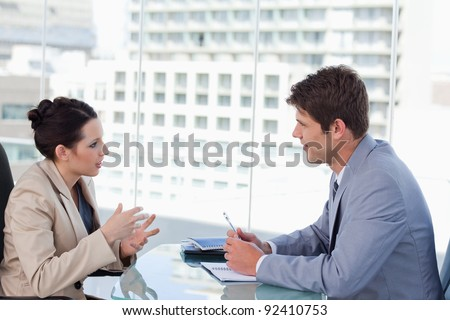 Business team negotiating in a meeting room - stock photo
