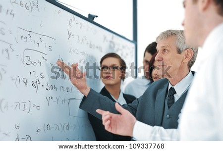 Business team of five discussing a project - stock photo