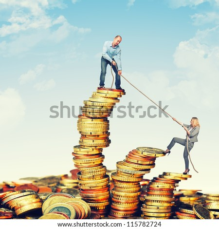 business team on euro coin piles - stock photo