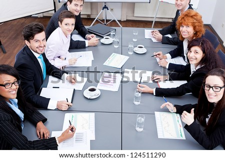 business team on table in office conference seminar presentation