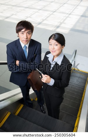 Business team on the escalator, view from above