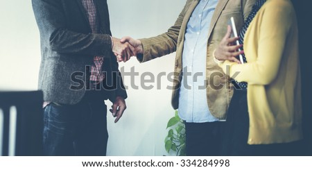 Business Team Partnership Greeting Handshake Concept - stock photo