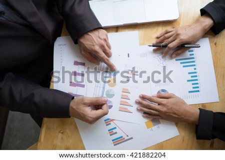 business team planing or discussing documents ,charts at meeting room. image of working process at business meeting - stock photo