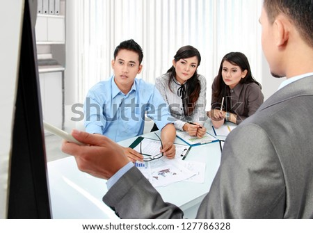 business team presentation in the office using whiteboard - stock photo