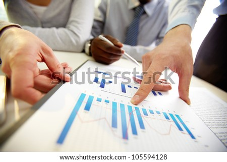 Business team presenting annual results of the established strategy - stock photo