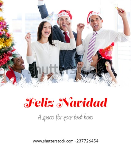 Business team punching the air to celebrate christmas against feliz navidad - stock photo