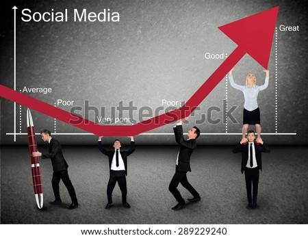 Business team push Social Media graphic arrow up - stock photo