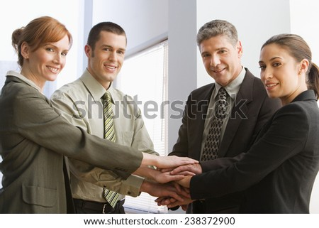 Business Team Putting Hands Together - stock photo