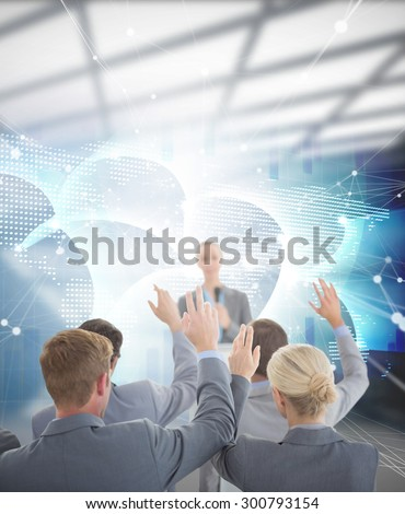 Business team raising hands during conference against global business graphic in blue