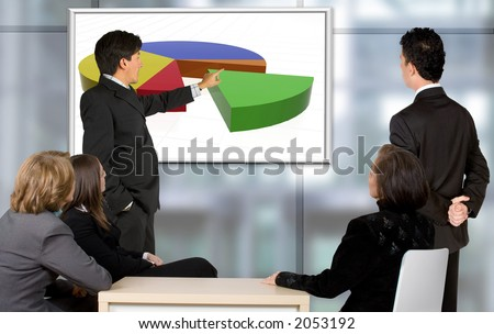 Business team receiving corporate trainning in an office - stock photo