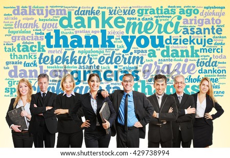 Business team saying thank you in different languagues  - stock photo