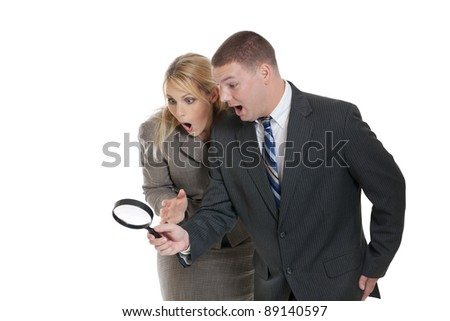 Business team searching for clues isolated on white - stock photo