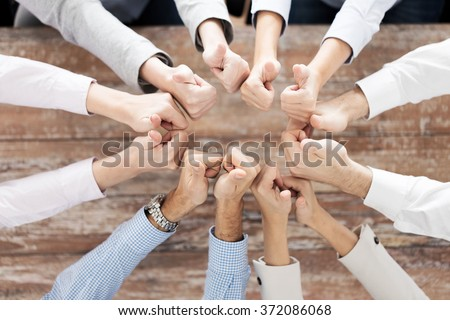 business team showing thumbs up - stock photo