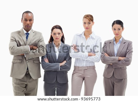 Business team side by side crossing their arms against white background - stock photo