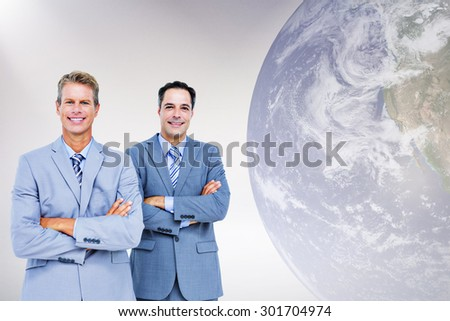 Business team standing arms crossed against grey background Business team standing arms crossed against a white screen - stock photo