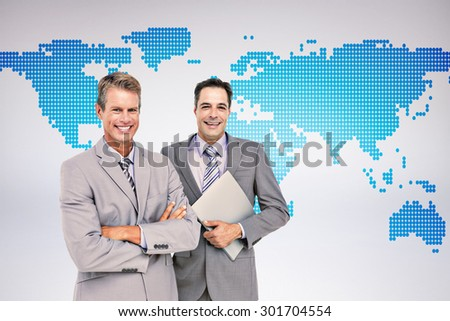 Business team standing arms crossed and with a folder against grey background Business team standing arms crossed and with a folder against a white screen - stock photo