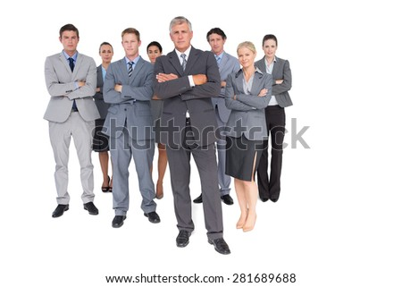 Business team standing arms crossed on white background