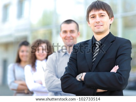 business team standing in a row at office and looking at camera - Successful business team - stock photo