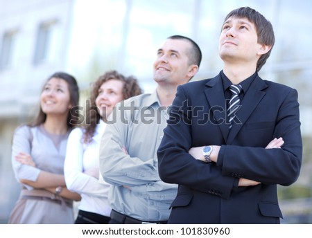 business team standing in a row at office and looking upwards - Successful business team