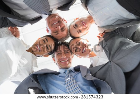 Business team standing in circle in the office