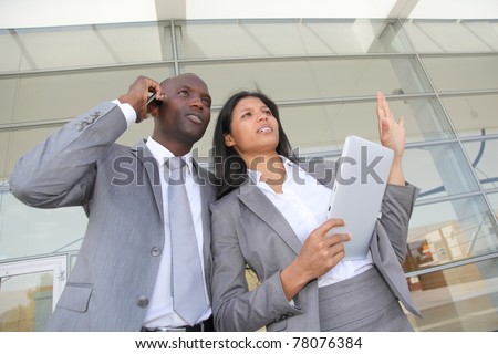 Business team standing outside congress center - stock photo