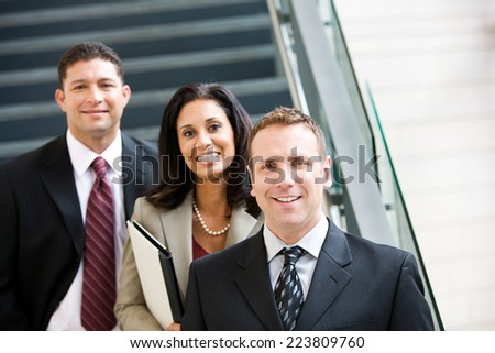 Business Team Standing Together By Steps - stock photo