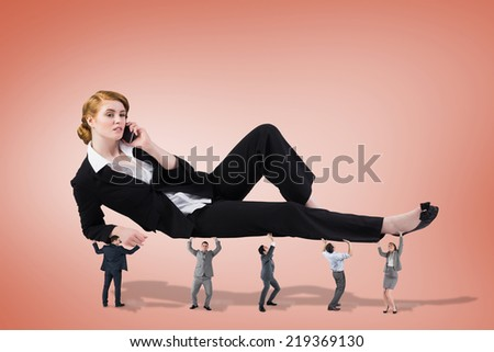 Business team supporting boss against orange background - stock photo