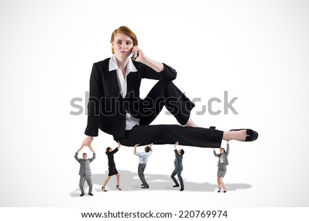 Business team supporting boss against white background - stock photo
