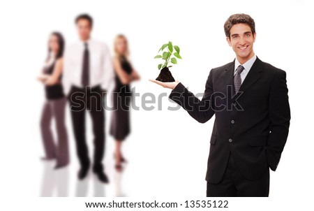 Business team supporting green environment - stock photo