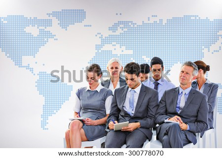 Business team taking notes during conference against blue world map on white background