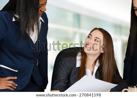 Business team talking to each other at a meeting - stock photo