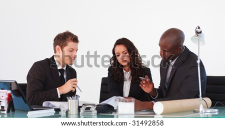 Business team talking to each other in a business meeting - stock photo