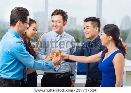 Business team toasting and celebrating success - stock photo