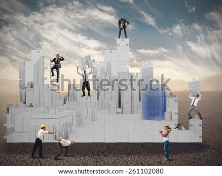 Business team together builds in the desert - stock photo