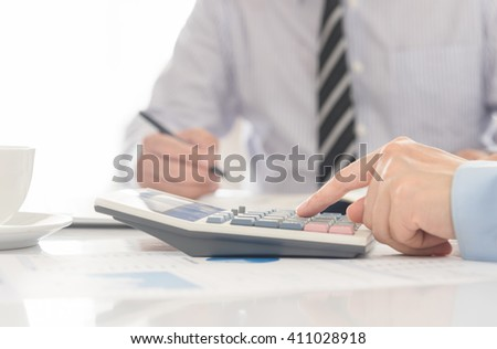 Business team together to discuss the business plan and analyze financial numbers to view the performance of the company. - stock photo