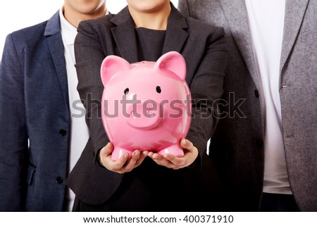 Business team-two men and woman holding piggybank