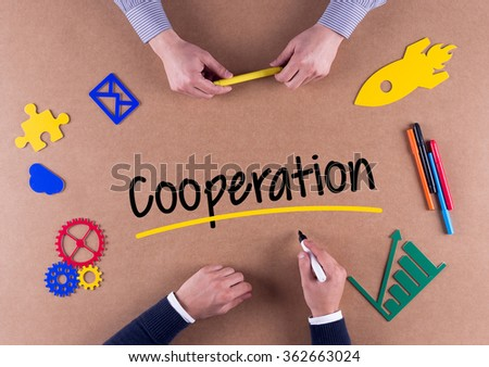 Business Team with a single word Cooperation - stock photo
