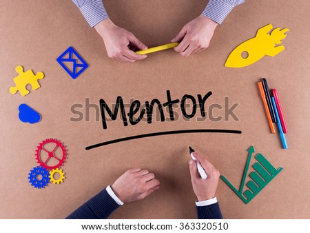 Business Team with a single word Mentor - stock photo