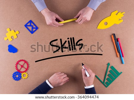 Business Team with a single word Skills - stock photo