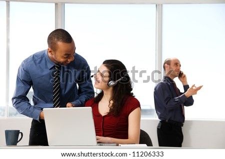 business team with a woman in the foreground - stock photo